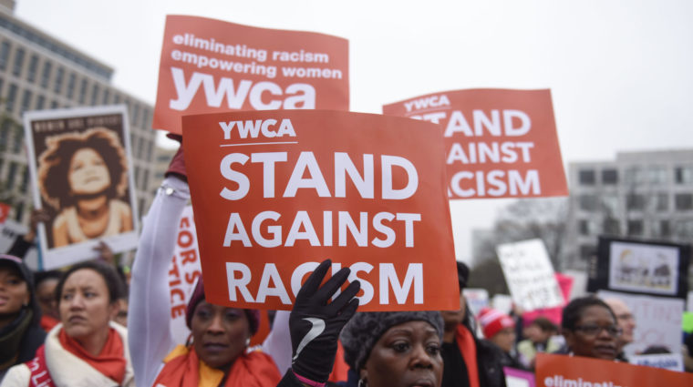 YWCA Women marching to stand against racism.